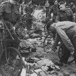 Royal Marine Commandos in Southern England immediately before D-Day, June 1944. They have BSA Airborne Bicycles with the Everest Carrier fitted to the front. They are having a kit inspection, so the loaded rucksack, rope etc. is not loaded onto the bicycles.