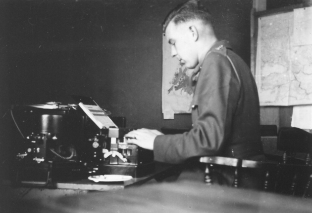 "Young officer typing at a code or cypher machine. Lieutenant A. H. Stevens typing on a code or cypher machine (?) - X in Saint John's, Newfoundland in 1942. At Winterholme, with Force ""W"" Headquarters."