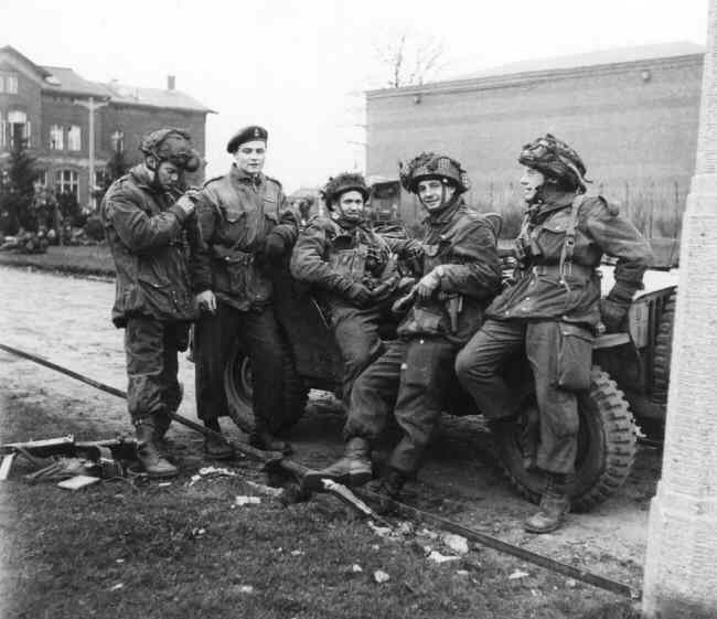 Greven, Germany, 1945.  Some 1 Canadian Parachute Battalion officers with a jeep.