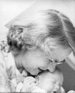 Mother holding newborn baby. Estelle Stevens holding her youngest child, the newborn Robert Duncan Stevens. Rome, Italy, 1962.