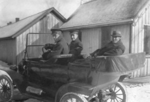 "p75-3 ""The P M"" (apparently the Prime Minister of Canada) in the back seat of a touring car escorted by two soldiers."