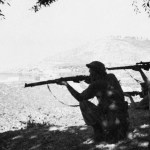 Two soldiers in silhouette firing rifles. British Commandos in Albania during WWII. Man on right has a No. 4 MK. I (T) They are likely with No 2 Commando. (Colin M. Stevens' Collection)