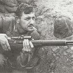 U.S. sniper Boitnott in Korea armed with an M1C sniper rifle fitted with an M81 or M82 Lyman scope.