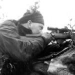 Canadian sniper aiming his No. 4 MK. I (T) sniper rifle. (L&AC PA136763)