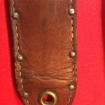 USMC Stiletto scabbard - front view of lower end showing the large grommet. This 4th version of scabbard does not have the metal plates. Colin M Stevens' Collection