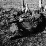 WWII British sniper demonstrating an unconventional shooting position, one often used in British match rifle competitions. It is a good position to drop into for a quick shot from sloping ground or to fit into a small shell hole or hide. WBSTTR - Shore 1948 fp 135 bottom
