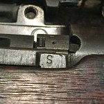 """""""S"""" mark on a No. 4 MK. I (T) indicating that the iron sights had been checked before the rifle was sent to Holland and Holland for sniper conversion."""