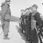 Brigadier General talking to soldiers.