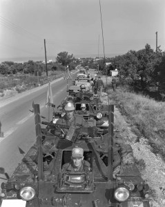 """Ferret 54-82569 with unique (?) twin wire cutter bars with UNFICYP, Cyprus in 1965. """"569"""" is painted in tiny (1""""?) numbers above the driver's head.  (DND photo CYP65-194-7)"""