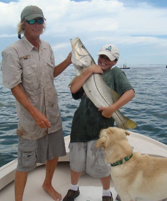 Big fish & happy child, Sanibel & Captiva Islands fishing.