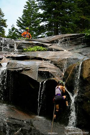 Carole climbs the falls