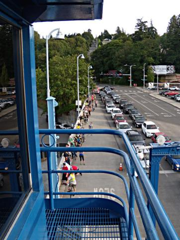 People waiting for the Fremont Bridge to lower back down so they can move across the bridge
