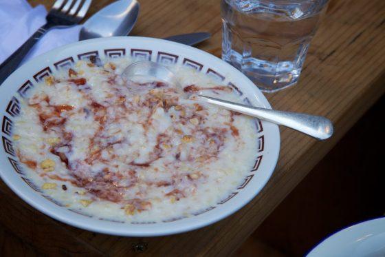Porridge with toasted hazelnuts and jam
