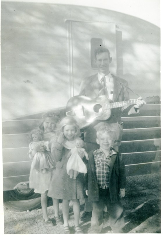 My guitar playing dad and my smiling sisters Cynthia and Linda and brother Richard