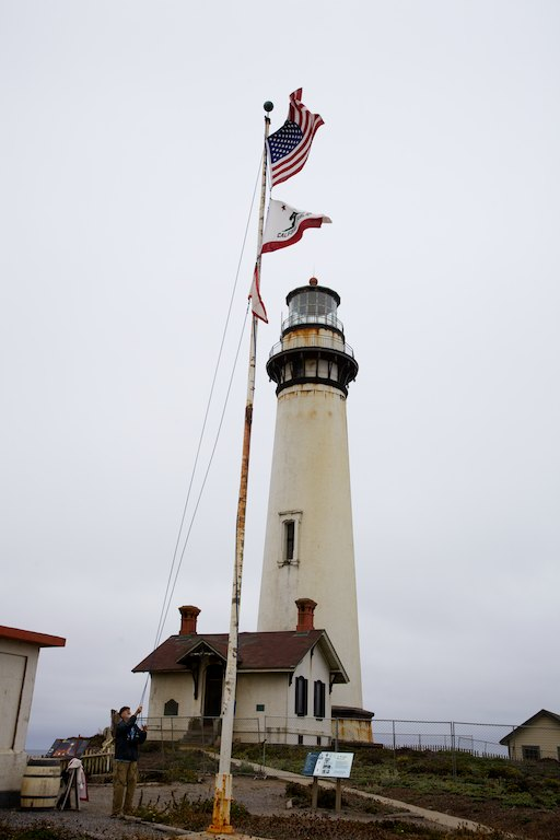 Morning flag raising at Pigeon Point Lighthouse