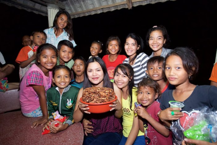 Agnes Albiso Tutwiler celebrating with the children at New Hope For Orphans. Poipet, Cambodia