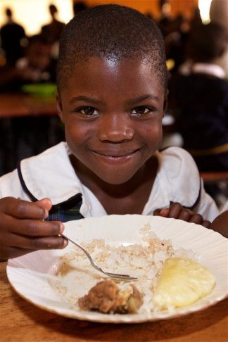 This student is enjoying a delicious meal, the best one she'll have for the day. I enjoyed the meal of beef rice and pineapple almost as much as I did the company