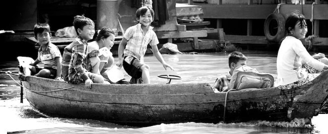 Children in Cambodia playing on the lake they call their home, surreal moment.