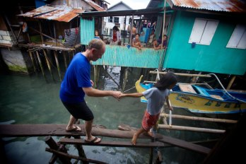 With a very special little girl in the Philippines... Badjao Bridge