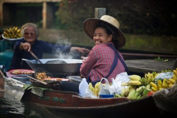 "Experiencing ""Thai smiles"" at the Floating market just outside of Bangkok, Thailand"