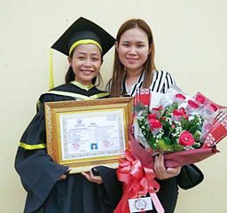 Chenda at her college graduation with her Big Sister by her side.