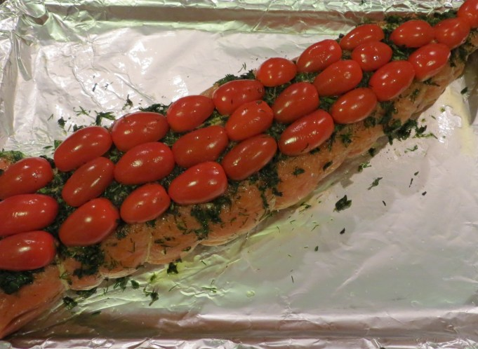 Baked stuffed salmon with tomato topping