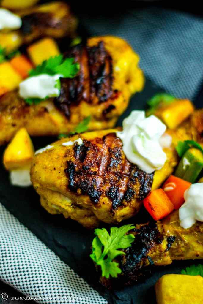 Grilled Chicken Tikka Drumsticks served on a plate