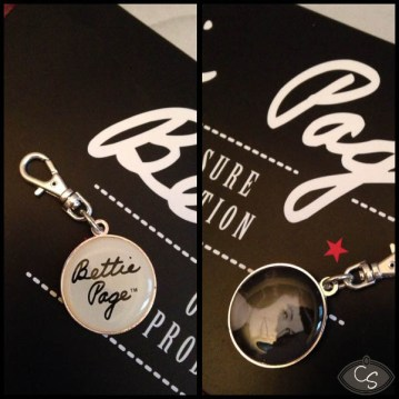 You get a charm with each item in the Bettie Page range!