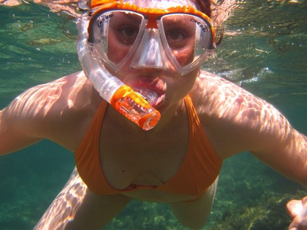 woman wet patch diving underwater article