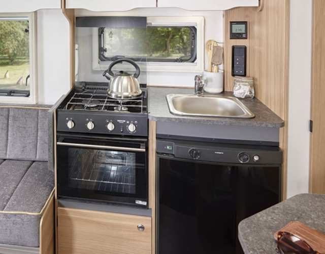 Well-specified kitchens feature a Dometic 103 litre refrigerator & 12 litre freezer with electric ignition plus a Thetford Triplex combination oven and grill with three gas burner hob