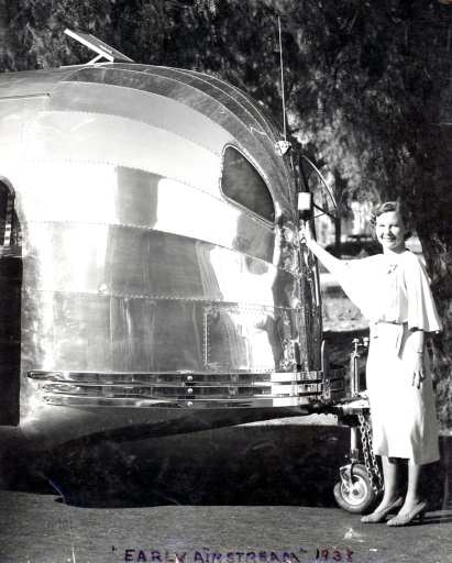 A 1938 Airstream Clipper being christened with a bottle of champagne. Courtesy of the Estate of Helen Byam Schwamborn.