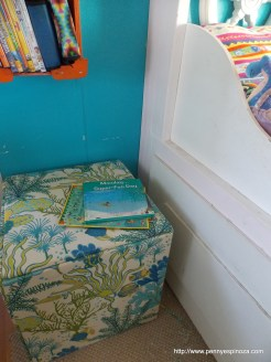 We covered four 18 inch square wood tiles with Under the Sea fabric