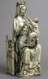 Virgin and Child. France, ca. 1275–1300. Ivory with paint and gold. The Metropolitan Museum of Art, New York, NY, gift of J. Pierpont Morgan, 1917.190.295 Large-scale Virgin and Child statuettes represent the apex of ivory carving in the Gothic period in France, and this sculpture is among the largest. Measuring 6.5 inches in diameter at its widest point, the solid statuette could only have been made from the tusk of a Savanna elephant. The artist has maximized the size of the figures of the Virgin and Child obtained from the large tusk and has added separate ivory pieces for the throne. This statuette was finished with fine details in paint and gold, another valuable commodity obtained from across the Sahara.