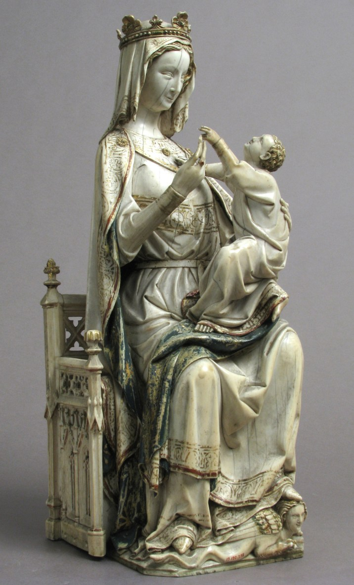 Virgin and Child, France, ca. 1275/1300. Ivory with paint, 36.8 x 16.5 x 12.7 cm. The Metropolitan Museum of Art, New York, gift of J. Pierpont Morgan, 1917, 17.190.295. Image © The Metropolitan Museum of Art. Image source: Art Resource, NY Large-scale Virgin and Child statuettes represent the apex of ivory carving in the Gothic period in France, and this sculpture is among the largest. Measuring 6.5 inches in diameter at its widest point, the solid statuette could only have been made from the tusk of a Savanna elephant. The artist has maximized the size of the figures of the Virgin and Child obtained from the large tusk and has added separate ivory pieces for the throne. This statuette was finished with fine details in paint and gold, another valuable commodity obtained from across the Sahara.