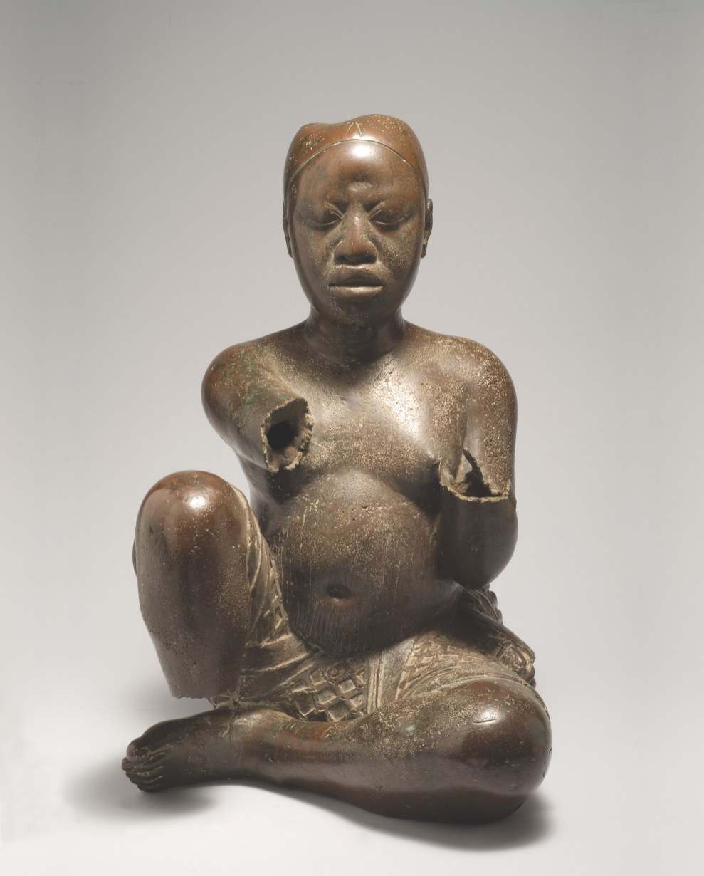 Seated figure, possibly from Ile-Ife, found at Tada, Nigeria, late 13th/14th century. Copper with traces of arsenic, lead, and tin, height 54 cm. National Commission for Museums and Monuments, Abuja, Nigeria, 79.R18. Photograph by Museum for African Art and The Fundación Marcelino Botín/ Karin L. Wilis The style and the extraordinarily thin casting of this naturalistic figure point to its likely creation at Ife, the royal capital of a powerful kingdom. In the early 20th century the figure was part of the ritual life of Tada, a small village on the banks of the Niger River 120 miles north of Ife. During the medieval period, Tada's location would have been of strategic importance to Ife, connecting it with long-distance trade. Analysis of the raw copper from which the statue is made suggests that it might have originated in France, traveling along these very trade routes to Ife, where it was cast.
