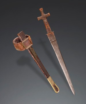 Knife and sheath. Tuareg, Hoggar-Aïr, Algeria, late 19th or early 20th century. Knife: wood, iron, and brass; sheath: leather Field Museum of Natural History, Chicago, IL, 175876. Photograph by John Weinstein