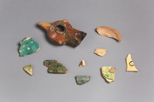 Fragments of glazed ceramics (among which is an oil lamp) excavated from Essouk-Tadmekka. Institut des sciences humaines, Mali. Photograph by Clare Britt