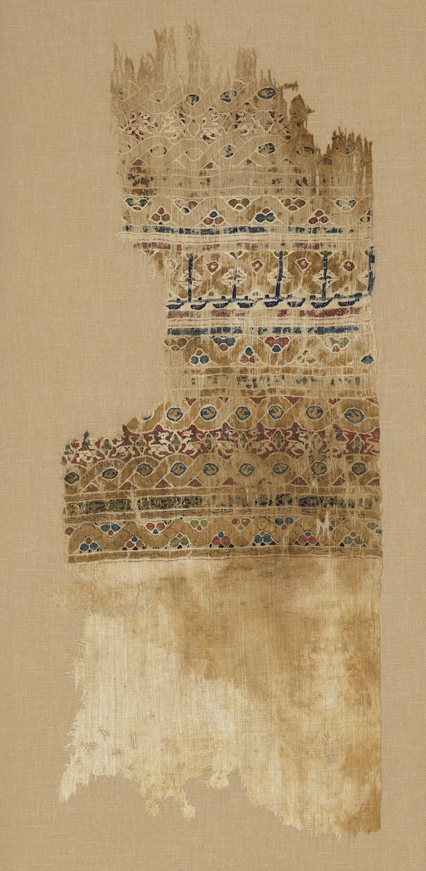 "Tiraz textile fragment. Egypt, 12th century. Linen and silk. Royal Ontario Museum, Toronto, Canada, Abemayor Collection given in memory of Dr. Veronika Gervers, Associate Curator, Textile Department (1968-1979) by Albert and Federico Friedberg, 978.76.504.A Extremely fine silk and linen tiraz textiles, occasionally embellished with gold-wrapped silk threads, were produced in private and state-run factories during the Fatimid and Mamluk periods, from the 10th to the 14th century. Many tiraz textiles bear inscriptions recording the names, titles, and dates of rulers, as well as declarations of faith. The ""robes of honor"" reportedly given to Mansa Musa were almost certainly tiraz, as they were among the high-value gifts presented to visiting dignitaries by rulers."