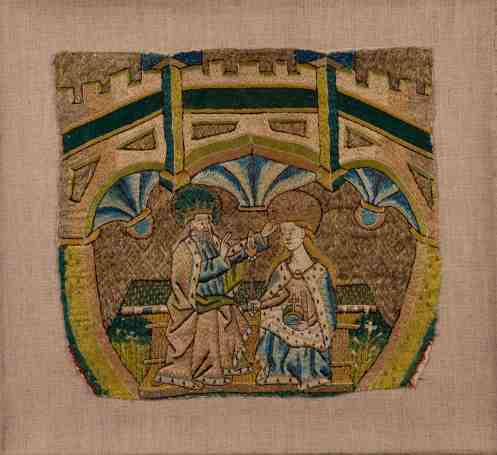Coronation of the Virgin, English, ca. 1480. Gold and silk thread on linen, 29.5 x 32.4 cm. Loyola University Museum of Art, Chicago, IL, the Martin D'Arcy, S.J., Collection, gift of D.F. Rowe, S.J., in memory of Mrs. Mary Flannery, 1976:01. Photograph by Clare Britt This densely embroidered textile fragment depicting the Coronation of the Virgin, a popular Christian story of the period, was likely once part of a vestment, or ceremonial robe. While documents of the period suggest that luxurious embroidered garments were worn by the elite, the majority of surviving embroideries were made for use in the church. Generous amounts of gold thread are incorporated into the scene. Despite the discovery of gold deposits in Europe in the later Middle Ages, West African gold continued to be highly prized for its quality and purity. A mid-seventeenth-century shipwreck offers compelling evidence for the export of West African gold to England. The ship sank off the coast of Devon, England, carrying scraps of gold jewelry, ingots, and more than 400 gold coins, most of them minted in Morocco between the eleventh and seventeenth century.