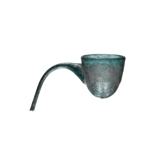 Spouted vessel, possibly Egypt or western Asia, ca. 800/1099. Blown glass, height 6 cm, maximum width 9.9 cm; rim diameter 4.5 cm. Collection of the Corning Museum of Glass, Corning, NY, 63.1.5 The slightly arcing shapes of these small tubes of green glass, excavated at Essouk-Tadmekka, Mali, suggest they were likely part of small spouted bottles. Made in Egypt or western Asia, such bottles were used throughout the medieval Mediterranean as containers for perfume or rose water. Material remnants of the long-distance trade of luxury glassware, fragments of glass vessels, such as this example from the Corning Museum, have also been found at other medieval sites north and south of the Sahara Desert.