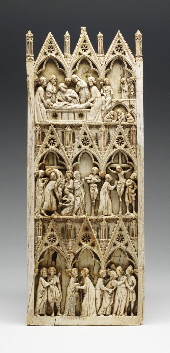"Diptych leaf with scenes from the Passion of the Christ, Paris, France, 1250/70. Ivory with traces of paint and gilding, 32.6 x 13 x .8 cm. The Walters Art Museum, Baltimore, MD, bequest of Henry Walters, 1931, 71.157 This is the left leaf of one of the earliest known Gothic ivory diptychs; the fragmentary remains of the right leaf are in the Musée de Cluny, Paris. The size of the panel, with a width that far exceeds 4.33 inches, indicates that it was taken from a Savanna elephant tusk. The artisan compensated for the natural curvature of the tusk by inserting a crescent-shaped piece of ivory to achieve a rectilinear shape. On the reverse, this ""operation"" is emphasized by a puncture-and-suture decoration, as if the pieces of ivory were sewn together."