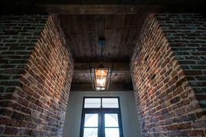 Hardwood ceiling and brick walls