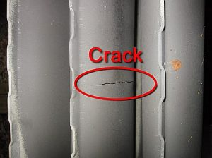 Small hairline crack at crimp of clam-shell on furnace heat exchanger