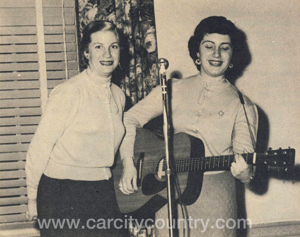 The Davis Sisters, Skeeter and Betty Jack. Snapshot ca. 1952, with microphone.
