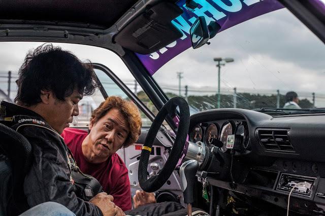 """Akira Nakai, founder of RWB, inside his RWB Porsche """"Rotana,"""" getting ready to go out on track"""