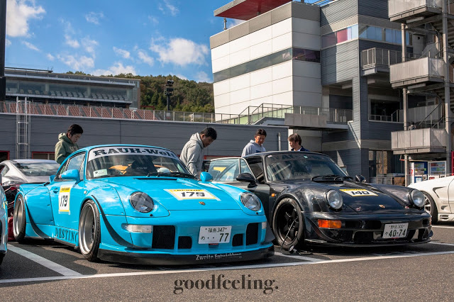 "RWB Porsche nicknamed ""Destino"" in light blue next to another black Porsche at Tsukuba Circuit, Japan"