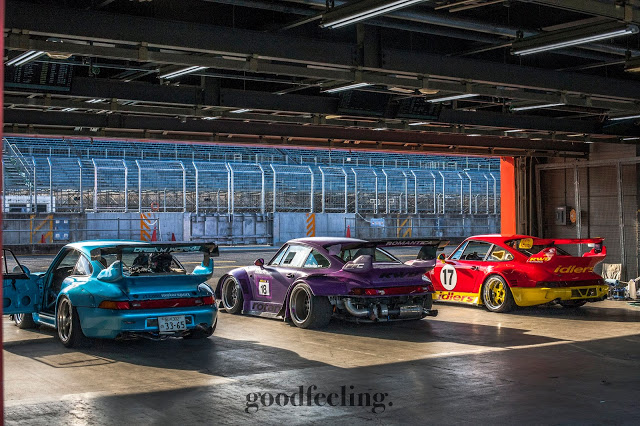 Three RWB Porsches at Twin Ring Motegi in a garage front the rear, preparing for the Idlers 12 hour endurance race