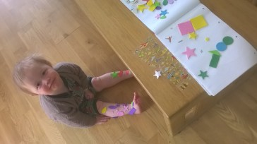 geometric stickers and a toddler