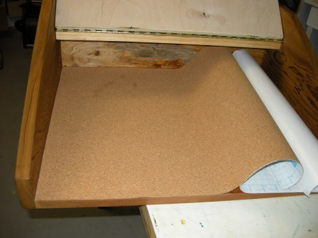 I lined the floor of the top with self-adhesive cork.