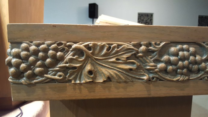 Grapes also trim the communion table.